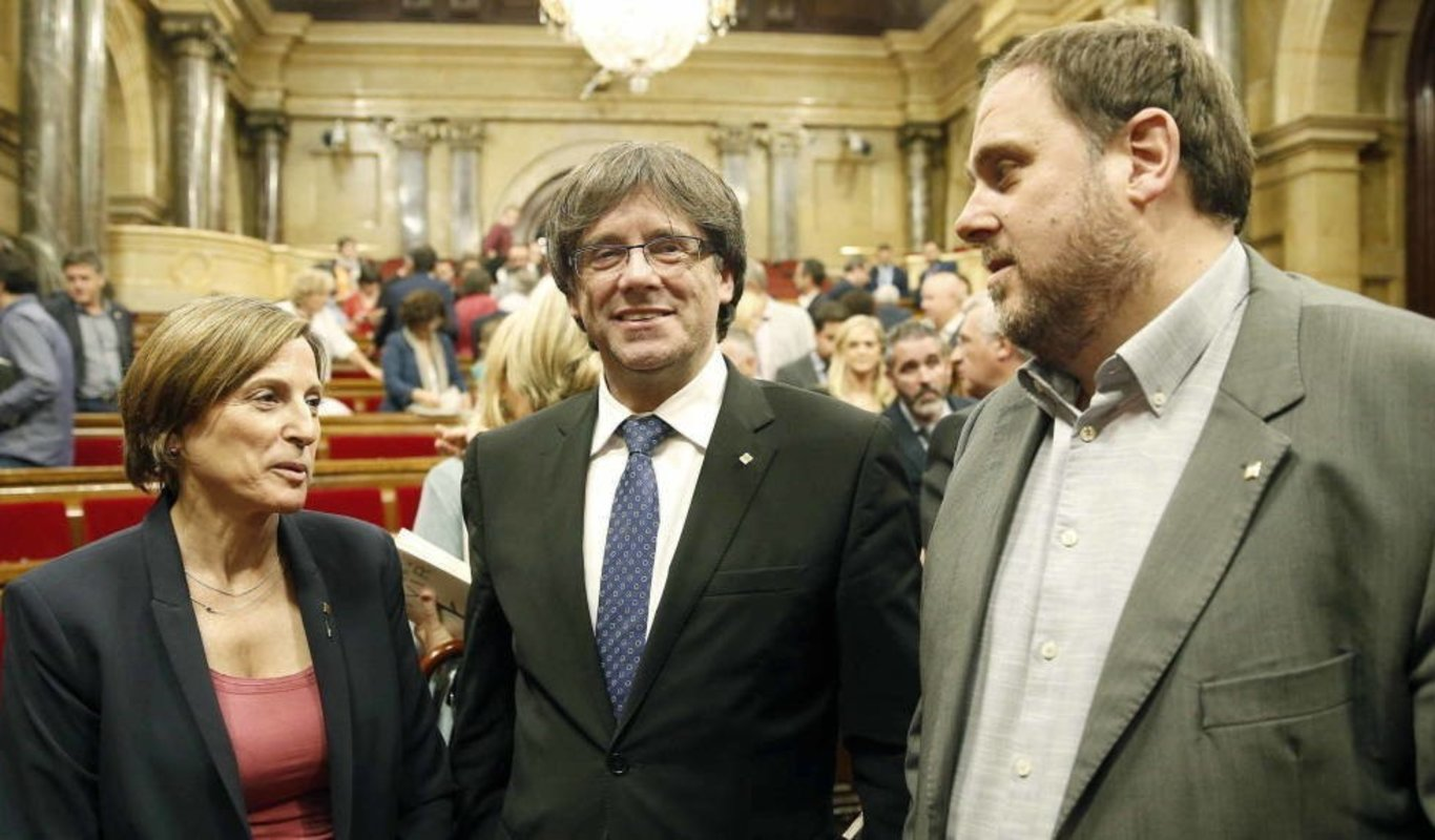 Carme Forcadell, Carles Puigdemont y Oriol Junqueras.