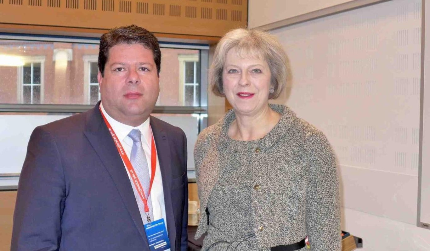 Fabian Picardo y Theresa May.